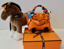 HERMÉS KELLY DOLL IN ORANGE  GULLIVER PALLADIUM HARDWARE